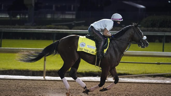 Kentucky Derby favorite Tiz the Law goes through a workout at Churchill Downs on Friday.