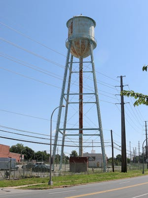 The old water tower on the former Playtex site in Dover will come down Wednesday to make room for a new development.