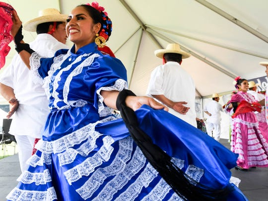Dancers with the Ballet Folkorico Mosaicos from Indianapolis entertain people attending the HOLA Latino Festival 2017 held at Evansville's Bosse Field Saturday, June 17, 2017.