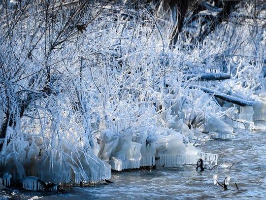 Near zero temperatures have ice coating the Ohio River