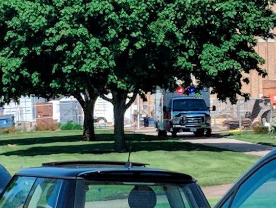 An emergency vehicle appears outside Dixon High School