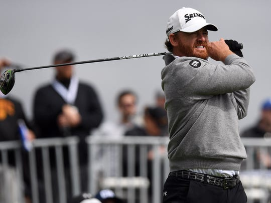 J.B. Holmes hits from the third hole tee box during the final round of the Genesis Open golf tournament at Riviera Country Club.
