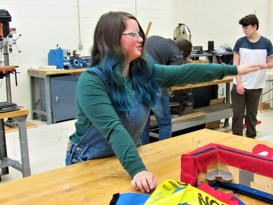 13-year-old Farragut Middle School student Lainey Gay joined the team early. Seen here repairing a part in the workshop, she plans on continuing with robotics in high school.