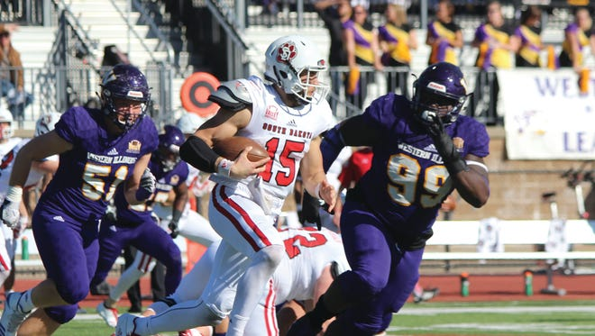 Chris Streveler attempts to avoid the Western Illinois defense on Saturday.