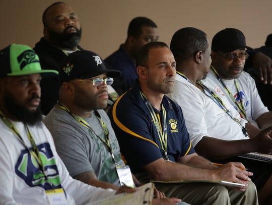 Metro Detroit high school football coaches listen to