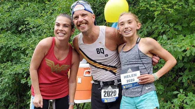 Jackie Blankenship (left) and Tom McGough (center) ran a virtual Boston Marathon, raising money for Kids Food Basket.