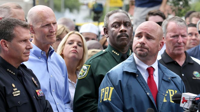 The faces of officials leading the response to the mass shooting in Orlando, near the nightclub where the shooting took place Sunday. From left, Orlando police Chief John Mina; Florida Gov. Rick Scott; Florida Attorney Gen. Palm Bondi; Orange County sheriff Jerry Demings; FBI assistant-agent-in-charge Danny Banks, and Orlando Mayor Buddy Dyer.