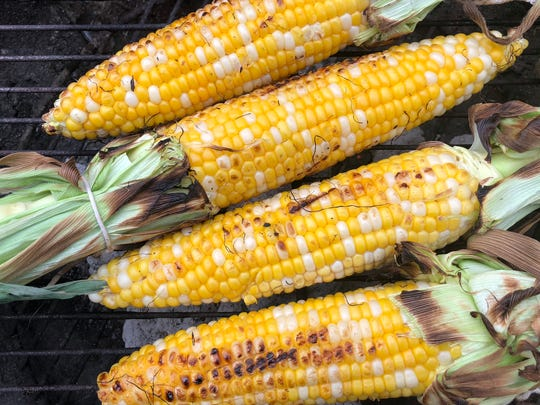 Sweet corn is best when stripped of its silk and husk and grilled over direct heat.