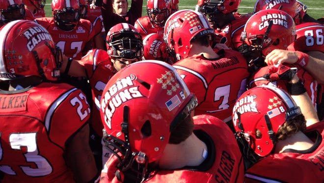 UL players prepare to hit the field in a game last season.