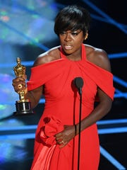 Viola Davis accepts the award for best supporting actress