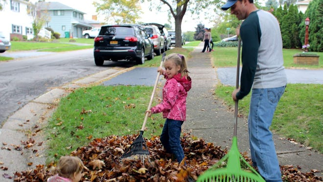 Family Raking (and Family Raking 2): Irondequoit resident Vinnie Esposito and his daughters Luciana (2) and Avery (6) joined more than 250 community volunteers for Irondequoit's first-ever Raking a Difference Day on Oct. 29.