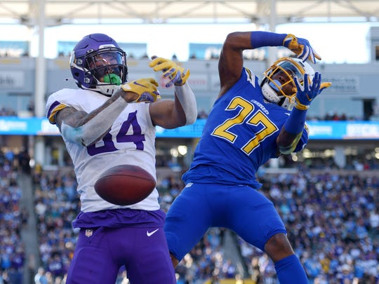 Dec 15, 2019; Carson, CA, USA; Minnesota Vikings tight end Irv Smith (84) cannot make a catch as Los Angeles Chargers free safety Jaylen Watkins (27) defends during the second quarter at Dignity Health Sports Park. Mandatory Credit: Jake Roth-USA TODAY Sports