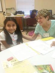 Mary Lynn Moser, right, a New Horizons volunteer, tutors