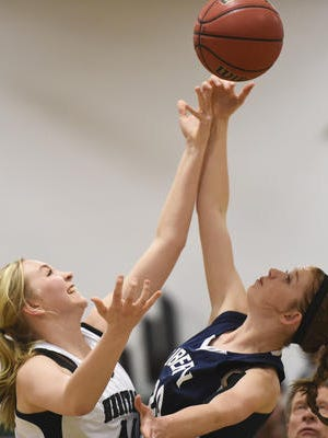 Halley Miklos (right), shown in a file photo, led Liberty Common with 24 points in the Eagles' 51-24 win over Peak to Peak at home Wednesday night.