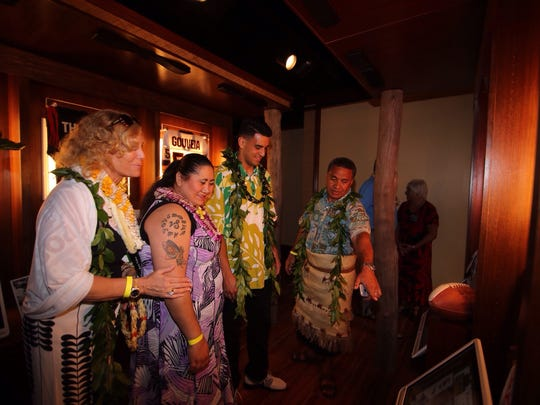 Marcus Mariota (center) checks out the displays in the exhibit gallery of the Polynesian Football Hall of Fame during its grand opening Jan. 24 in Oahu, Hawaii.