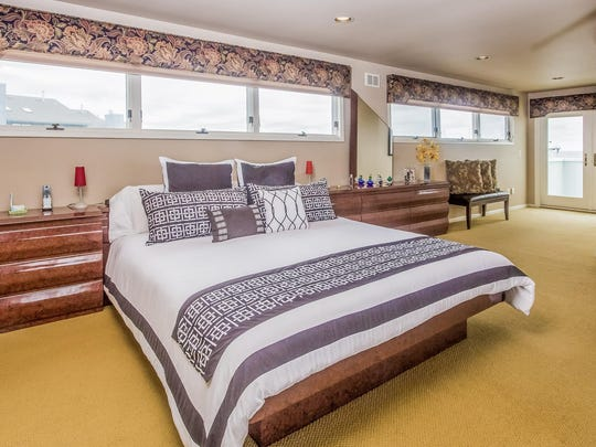 The master bedroom of this Monmouth Beach home has panoramic waterfront views.