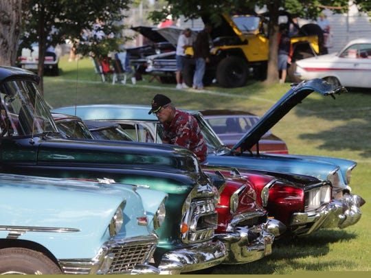 Classic cars draw admirers to Royal Oak's Memorial Park on Aug. 15, 2014, as part of last year's Woodward Dream Cruise festivities. This year, car buffs and others looking to enjoy the spectacle are invited to park there.