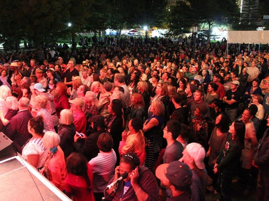 A crowd watches Al Jarreau at the 2014 Iowa Soul Festival on Sept. 19, 2014, in Iowa City.