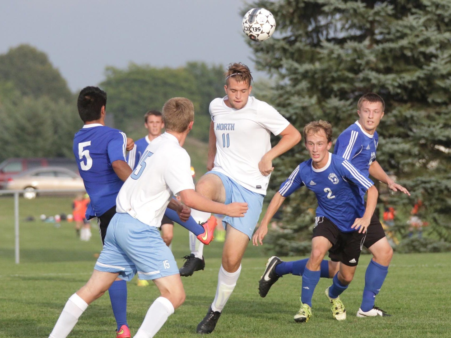 Sheboygan North's Nicolo Vitale (11) heads a ball forward during Thursday's match against Oshkosh West. Vitale had a hat trick in the Golden Raiders' 3-0 win.