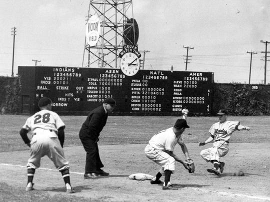 This 1950s photo shows the Indianapolis Indians in action at Victory Field, formerly Perry Stadium, with ivy adorning the outfield walls.