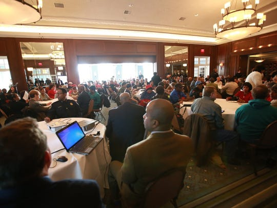 People gather Tuesday, March 10, 2015, at the Detroit Golf Club in Detroit for a community meeting about public safety in University District neighborhood.