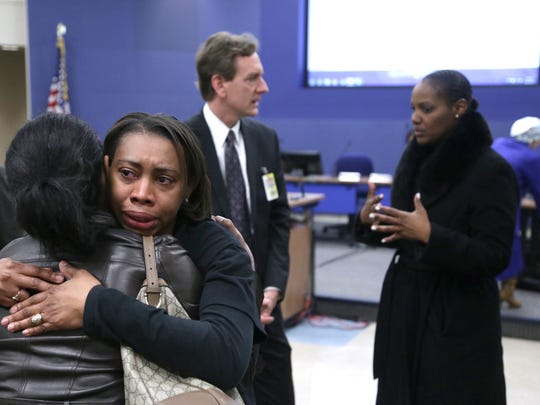 Bloomfield Hills PTO Council District Rep for Diversity Stephanie Crider is hugged by Nicole Harris President of Bloomfield Hills African American Family Network after a Bloomfield Hills School Board meeting.