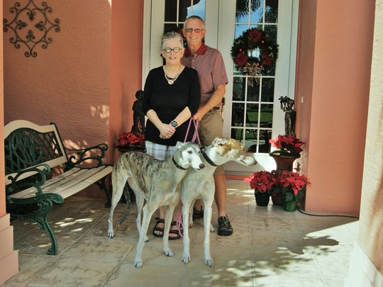 Naples residents Ellen and Bob Schmidt adopted two greyhounds, Survivor and Caddy, from the Naples-Fort Myers Greyhound Racing & Poker Room. Pictured, from left to right, Ellen, Bob, Survivor and Caddy