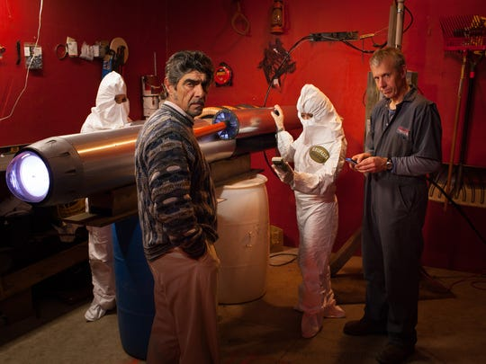 """Characters played by Mark Moede and Joel Kersebet, front from left, and biohazard-suited Kay Allmand and Holly Erskine, back from left, steal the alien generator for Exeflux Energy Corp. in a scene from """"The Emissary."""" The feature movie, written and directed by Tim Erskine of Sister Bay and shot mostly in Door County, has its world premiere Feb. 27 at Door Community Auditorium."""