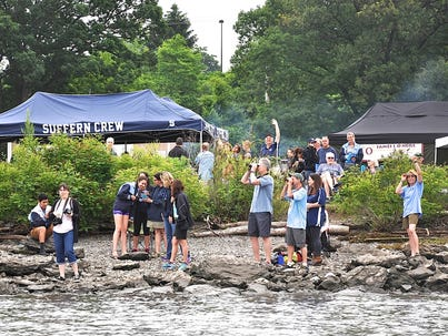 Suffern crew members, parents and other fans watch