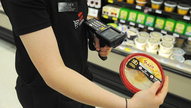 Kelsey Wagner, Hy-Vee Aisles Online manager, fills a customer's order at the store on South Minnesota Avenue.