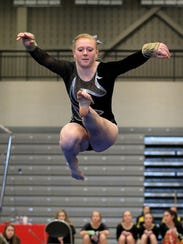 Plymouth junior Emily Welch performs her floor exercise