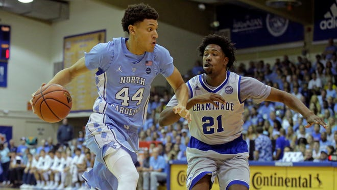 UNC's Justin Jackson drives around Chaminade guard Rohndell Goodwin in the first half.
