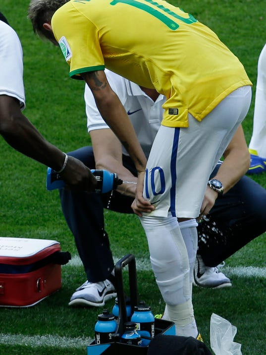 Brazil's Neymar gets treatment during the World Cup round of 16 soccer match between Brazil and Chile at the Mineirao Stadium in Belo Horizonte, Brazil, Saturday, June 28, 2014. (AP Photo/Hassan Ammar)