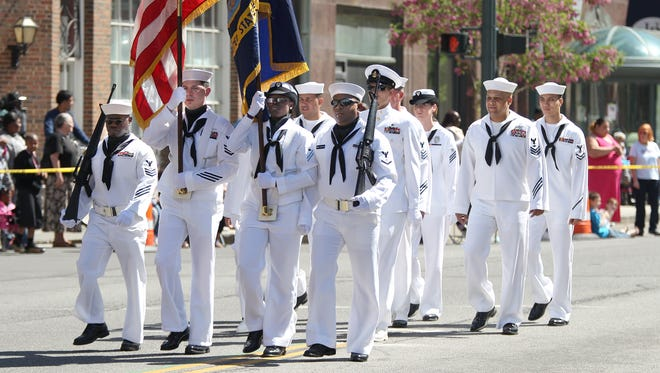 Memorial Day parades will be held in municipalities throughout the region. File photo of representatives of the U.S. Navy  marching in the Memorial Day Parade on Main Street in downtown Rochester.