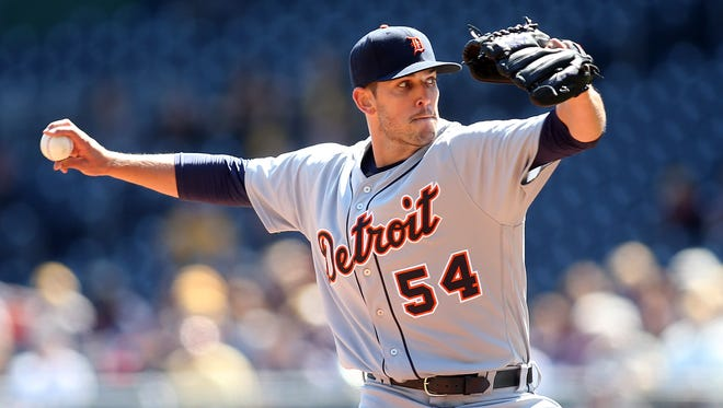 Apr 14, 2016; Pittsburgh, PA, USA; Detroit Tigers relief pitcher Drew VerHagen (54) pitches against the Pittsburgh Pirates during the seventh inning in an inter-league game at PNC Park.