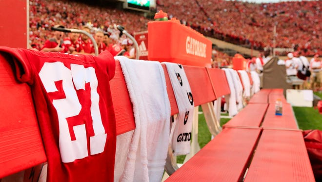 The jersey of deceased Nebraska punter Sam Foltz (27) is draped on the bench before the game against Fresno State Saturday in Lincoln, Neb.