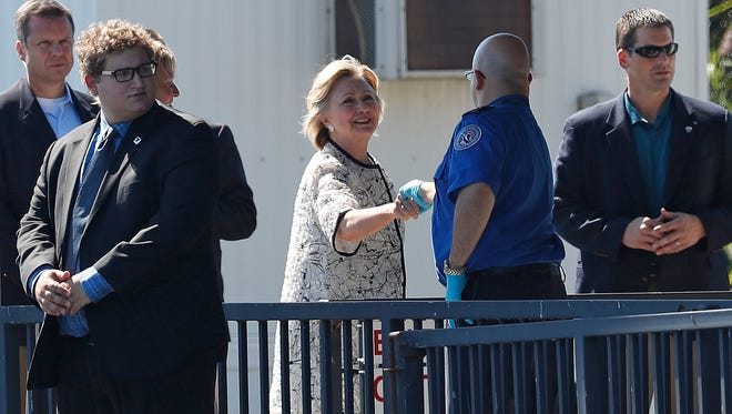 Democratic presidential candidate Hillary Clinton greets people as she arrives at Provincetown Municipal Airport in Provincetown, Mass., Sunday, Aug. 21, 2016. Clinton is traveling to a fundraiser at the Pilgrim Monument and Provincetown Museum in Provincetown.
