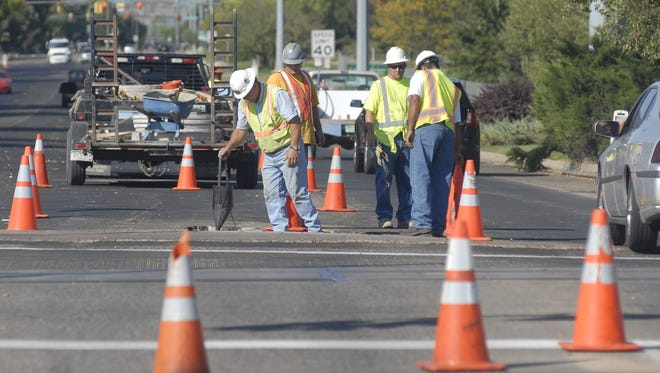 Construction crews work on a road maintenance project in this Coloradoan file photo. The city is getting ready to begin nighttime roadwork to repair cracks in major roads.