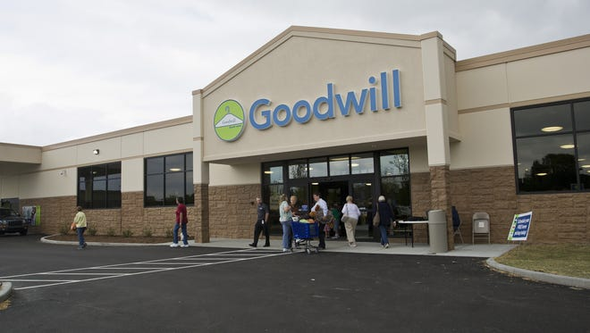 Journal & Courier file photo The Goodwill store in West Lafayette. Cathleen Selig drops off a donation to Cody Bryant of the new Goodwill Store Tuesday, August 12, 2014, in West Lafayette. Te store had their grand opening Tuesday.