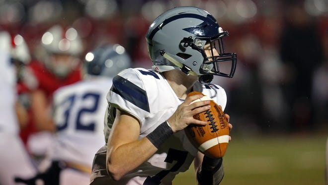 West Clermont quarterback Tyler Steinker rolls out to pass in the game between the West Clermont Wolves and the Milford Eagles at Milford High School October 27, 2017.