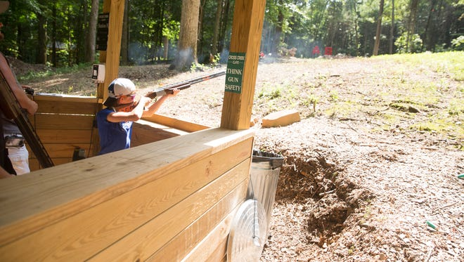 Kenley Brogdon, 12, of the South Gibson County Shooting Sports team, fires shots at Cross Creek Clays, a sporting clays destination in Palmyra, Tenn.