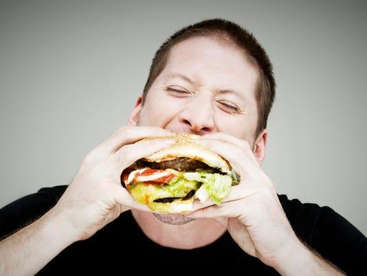 Ask-Amy-man-eating-burger
