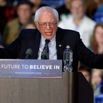 """Democratic presidential candidate, Sen. Bernie Sanders, I-Vt. speaks during a rally at Grand Valley State University Field House Arena in Allendale, Mich. on Mrch 4. They may be on opposite ends of the political spectrum, but Sanders and Donald Trump appear to be sharing a catchphrase, which is """"huge."""""""