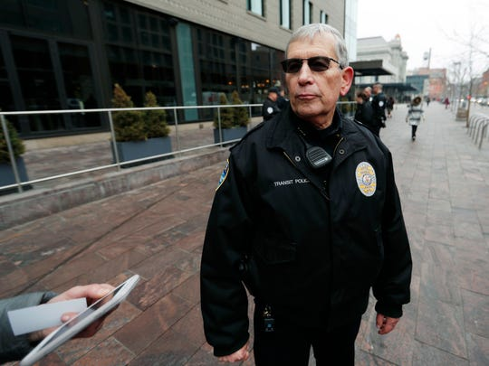 Regional Transportation District police chief John Tarbert talks to reporters early Wednesday, Feb. 1, 2017, near the scene where a contract transit security officer was shot and killed late Tuesday, Jan. 31 in Denver. Police have not released any details about the shooting, which took place by the city's main transit hub, Union Station. (AP Photo/David Zalubowski)