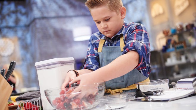 """Cody Vasquez, 12, of Gilbert, is one of eight contestants between 10 and 13 years old competing on the """"Kids Baking Championship,"""" a four-part series that starts Monday, Feb. 2 on the Food Network."""