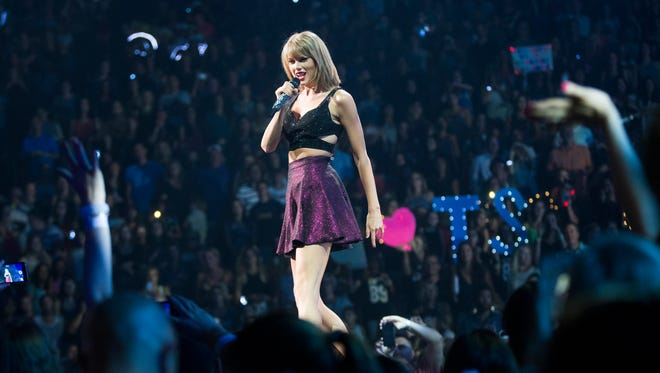 """Taylor Swift performs for fans during the opening night of a two-night stand during her """"1989"""" tour at Gila River Arena in Glendale August 17, 2015."""