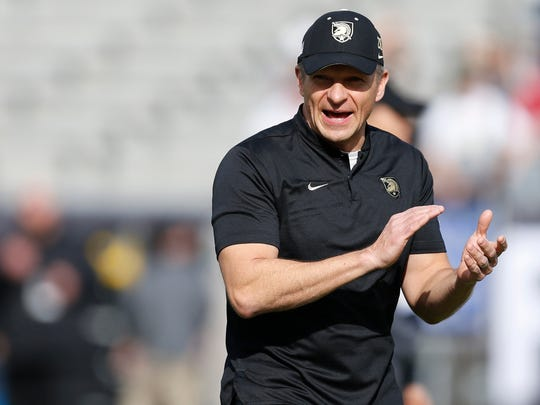 FILE - In this Dec. 22, 2018, file photo, Army head coach Jeff Monken watches as his team warms up before they play Houston in the Armed Forces Bowl NCAA college football game, in Fort Worth, Texas. Army looks to bounce back from a tough overtime loss to Michigan when the Black Knights take on UT-San Antonio, Saturday, Sept. 14, 2019. (AP Photo/Jim Cowsert, File)
