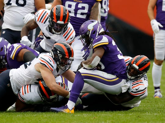Members of the Chicago Bears defense stops Minnesota Vikings running back Dalvin Cook during the half of an NFL football game Sunday, Sept. 29, 2019, in Chicago. (AP Photo/Charles Rex Arbogast)