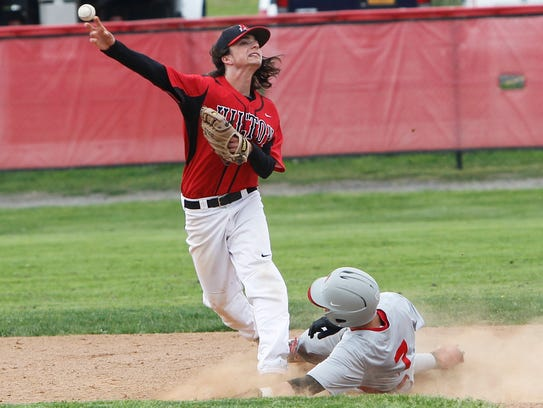 Hilton's Alex Hendry, left, tries to turn a double