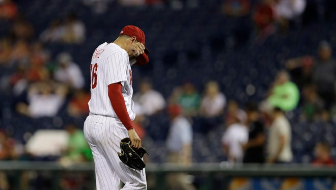 Philadelphia Phillies' Jeanmar Gomez walks off the field after getting pulled during the ninth inning Tuesday against the Chicago White Sox in Philadelphia.